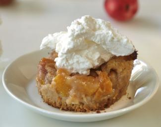 Peach cobbler with whipped cream